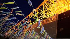 Fancy carp flags underneath the Tokyo tower, Tokyo Japan Stock Footage