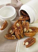 Pecan nuts in a porcelain tin Stock Photos
