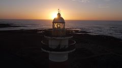 AERIAL: Flying over the lighthouse at sunset Stock Footage