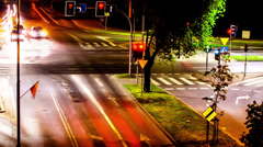 Crossroad with traffic lights, street at night, time lapse, 25s long Stock Footage