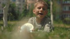Small, cute boy 6 years makes sunbeams. slow-motion Stock Footage