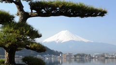 Stock Video Footage of Mt. Fuji rises above Lake Kawaguchi