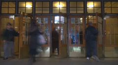 Timelapse train station grand central door entrance people enter hall tourist US Stock Footage