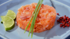 Salmon tartare with chives, pepper and lime - stock footage