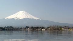 Stock Video Footage of Mt. Fuji rises above Lake Kawaguchi
