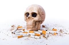 Antismoking concept with cigarettes and skull Stock Photos