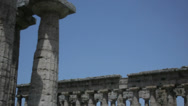 Stock Video Footage of Collumns of Two Ancient Greek Temples Blue Sky Background - 25FPS PAL