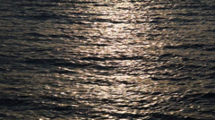 Beautiful sunset reflection sparkles on tiny ripples of sea water Stock Footage