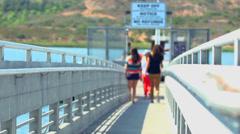 People Walking on Small Bridge Stock Footage