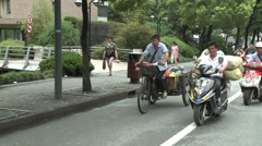 Scooters and bicycles mixed on street - stock footage