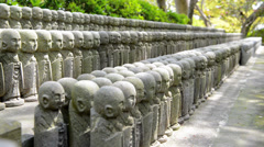 Little Buddha statues at Kamakura, Japan - stock footage