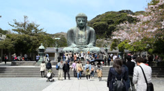 Unidentified people paying respect to great buddha (Daibutsu) sculpture - stock footage