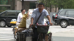Tricycle on busy road Stock Footage