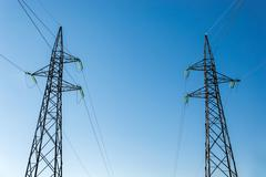 high-voltage electricity pylons, view from below - stock photo