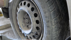 Removal - Refitting the wheel. Tire automobile wheel.  Stock Footage