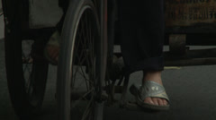 CU feet pedalling + front wheel Stock Footage