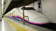 A Japanese Bullet Train (Shinkansen) departs from Ueno Station Stock Footage