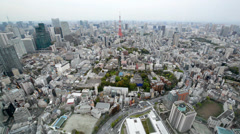 High angle view over city buildings and streets in Central Tokyo Stock Footage