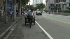 Tricycle loaded wit waste on busy street Stock Footage