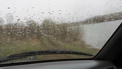 Rain drops on a car windshield Stock Footage