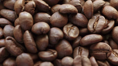 Hand checking coffee beans closeup, made from raw Stock Footage