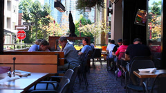 People on a yaletown patio Stock Footage
