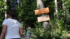 Woman starts the grouse grind hike Stock Footage