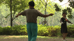 Man with yo-yo in park Stock Footage