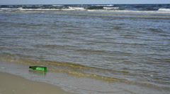 Message in a bottle at a beach Stock Footage