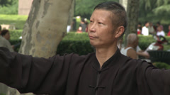 Man does Tai Chi in Park 1 Stock Footage