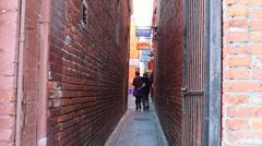 People walking in fan tan alley Stock Footage