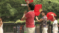 Dancing with fans Stock Footage