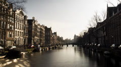 View at a canal in Amsterdam zoomed out and in a time lapse mode. Stock Footage