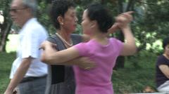 Two women dancing in park Stock Footage