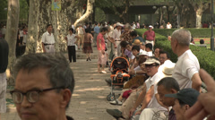 Large crowd dancing under trees 4 Stock Footage