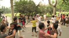 Large crowd dancing under trees 3 Stock Footage