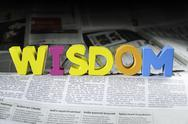 Stock Photo of word wisdom on newspaper
