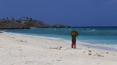 Man walking on the beach in island Malapascua, Philippines Stock Footage