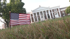Stock Video Footage of 911 rememberance small flag with historic building WS