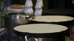 Pancake cooking and serving Stock Footage