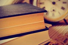 Stock Photo of old books and an old alarm clock, with a retro effect