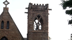 Stone church on campus spire and tower Stock Footage