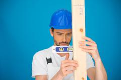 workman using a spirit level - stock photo