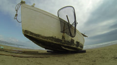 Italy - Fishing boat on the beach - wide lens shot Stock Footage