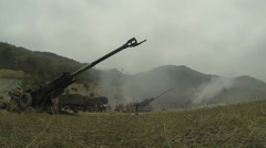 Artillery gun line firing for effect at SSang Yong 2014 Stock Footage