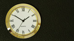 Watch with Roman numerals is located on the left - stock footage