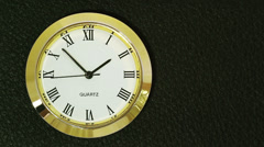 TIME-LAPSE: Watch in golden case with Roman numerals - stock footage