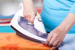 ironing clothes - stock photo