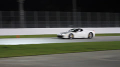White Ferrari 458 on race track at night Stock Footage