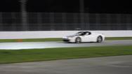 White Ferrari 458 on race track at night Stock Footage